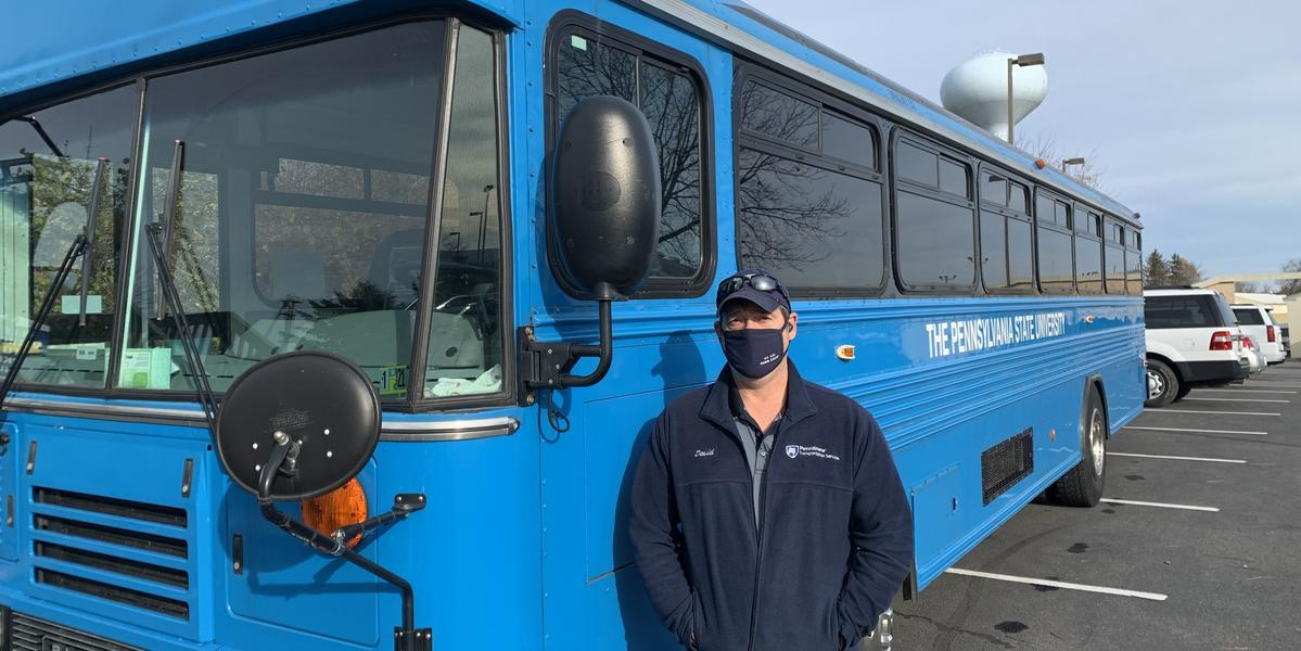 Blue bus and driver